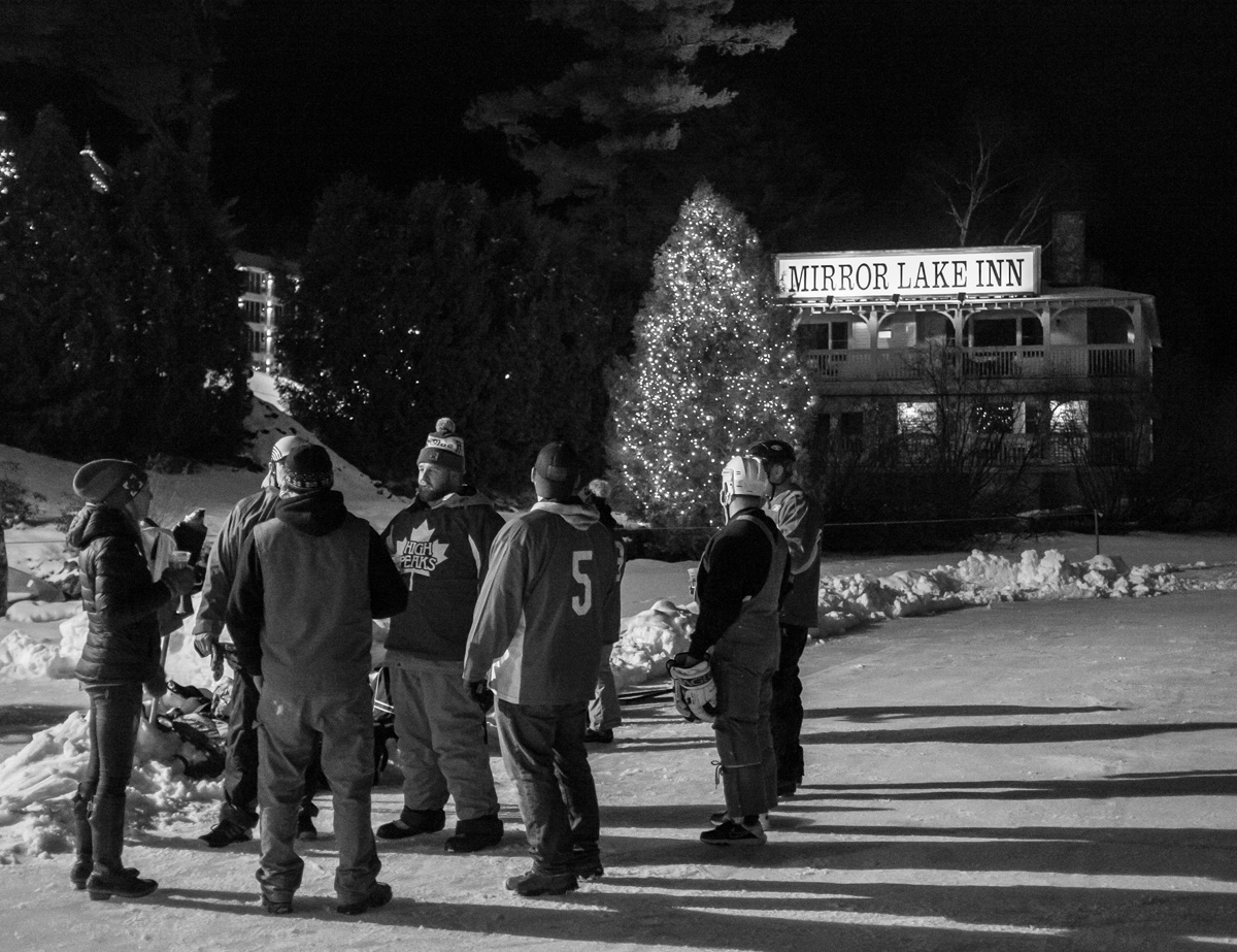 People standing on Ice at the Mirror Lake Inn